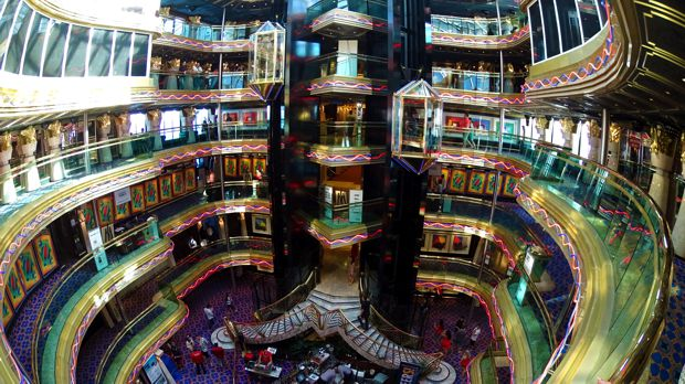 The Atrium features a glass elevator and bar, and stretches from decks 7 through 12.
